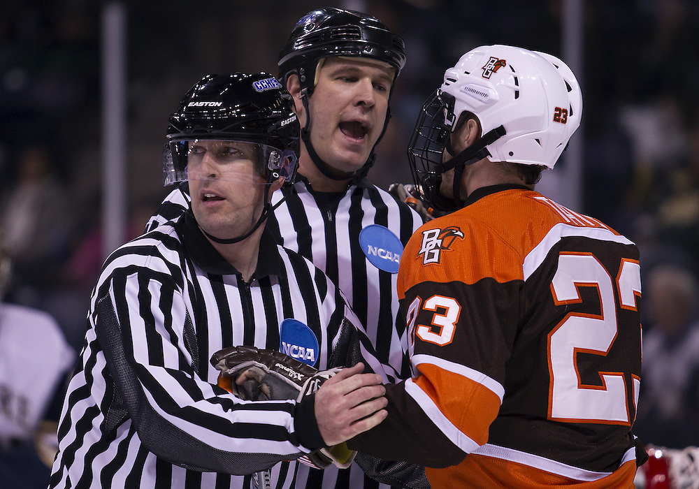 March 15, 2013:  The Linesmen control Bowling Green forward Brent Tate (23) during NCAA Hockey game action between the Notre Dame Fighting Irish and the Bowling Green Falcons at Compton Family Ice Arena in South Bend, Indiana.  Notre Dame defeated Bowling Green 1-0 in overtime.