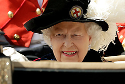 Queen Elizabeth II leaves by carriage during the annual Order of the Garter Service at St George's Chapel, Windsor Castle.