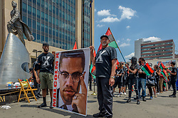 "May 19, 2017 - New York, United States - In honor of the 92nd Anniversary of the birth of black national hero, Malcolm X, on May 19, 2017; members of December 12th Movement, Black Lives Matter Greater New York and Harlem residents gathered outside Adam Clayton Powell State Office Building, 163 W. 125th St. to hold the 28th annual black power ""Shut 'Em Down"" rally and march. (Credit Image: © Erik Mcgregor/Pacific Press via ZUMA Wire)"