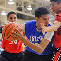 040314       Cable Hoover<br /> <br /> Arizona's Stevin Nelson (21) pushes past New Mexico's Hiram Gleason (14) during the Arizona New Mexico Allstars match at Miyamura High School Thursday.