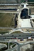 Nederland, Oude Moerdijkpolder, Bredase dijk08-03-2002; aanleg van viaduct over bestaand spoor en toekomstige HSL sporen; zandlichaam nu bedekt met zwarte bitumen om verstuiving tegen te gaan; onder in beld de A16 / a59, deze wordt gereconstrueerd en krijgt 2 x 3 rijbanen; infrastructuur verkeer en vervoer spoor trein mobiliteit transport  wegenbouw landschap;<br /> luchtfoto (toeslag), aerial photo (additional fee)<br /> foto /photo Siebe Swart