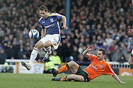 Coca Cola championship,Cardiff city v Plymouth Argyle at Ninian Park in Cardiff on Sunday 28th December 2008. pic by Andrew Orchard, Andrew Orchard sports photography. Roger Johnson of Cardiff City jumps over the tackle from Steve Maclean.