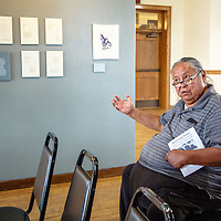 Albert Tinhorn talks about the pride he feels in seeing his brother's, Henry Tinhorn, work included in the art show at the Gallup Cultural Center Saturday afternoon.