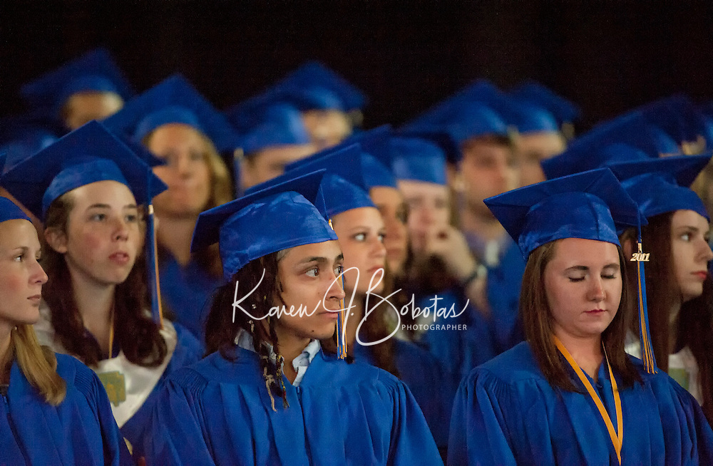 Henry Armando Oram Allen listens attentively with his fellow graduates during Gilford High School's commencement exercises at Meadowbrook Pavilion Saturday morning.  (Karen Bobotas/for the Laconia Daily Sun)Gilford High School Graduation at Meadowbrook Pavilion Saturday, June 11, 2011.