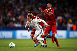 Real Madrid's Luka Modric gets away from Sevilla's Steven N'Zonzi