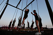 Recruits in the first phase of their training pull themselves up a rope as part of the physical training stations that they alternate at during the early morning.  Marine Corps Recruit Depot at Parris Island in South Carolina is where all male recruits living east of the Mississippi River and all female recruits from all over the US receive their arduous twelve week training in their quest to become marines. Even though there are two current active wars and a weak economy, recruitment has not been effected.  Actually, recruiting numbers have increased, with more young men and women looking toward the military for answers.