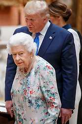 Queen Elizabeth II with US President Donald Trump view a special exhibition in the Picture Gallery of items from the Royal Collection of historical significance to the US, following a private lunch at Buckingham Palace in London, on day one of his three day state visit to the UK.