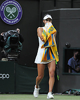 Lawn Tennis - 2021 All England Championships - Week Two - Monday - Wimbledon<br /> Emma Raducanu v Ajia Tomijanovic<br /> <br /> Emma Raducanu of GBR holds her towel to her face, asking for the doctor, to receive medical treatment in the 2nd set, which resulted in her having to retire from the match<br /> <br /> Credit : COLORSPORT/Andrew Cowie