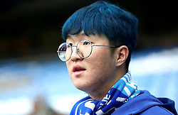 A Chelsea fan in the stands prior to the match