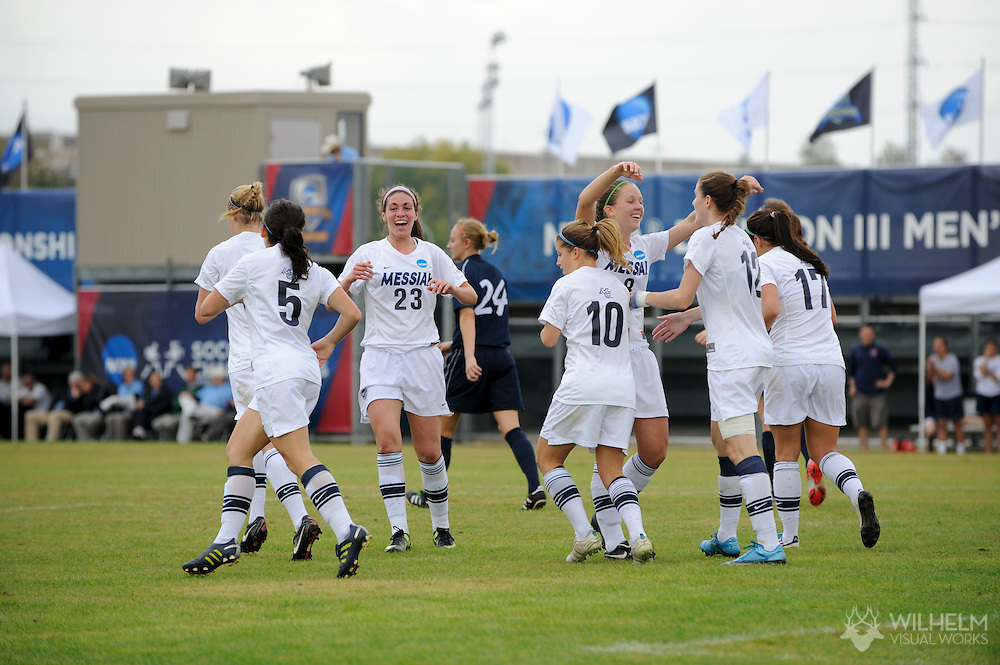 02 DEC 2011:  Teammates congratulate Erin Hench (12) of Messiah College on her goal against Wheaton College during the Division III Women's Soccer Championship held at Blossom Soccer Stadium hosted by Trinity University in San Antonio, TX. Messiah defeated Wheaton 3-1 to win the national title. © Brett Wilhelm