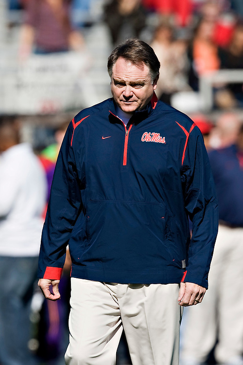 OXFORD, MS - OCTOBER 24:   Head Coach Houston Nutt of the Ole Miss Rebels watches his team warm up before a game against the Arkansas Razorbacks at Vaught-Hemingway Stadium on October 24, 2009 in Oxford, Mississippi.  The Rebels defeated the Razorbacks 30 to 17.  (Photo by Wesley Hitt/Getty Images) *** Local Caption *** Houston Nutt