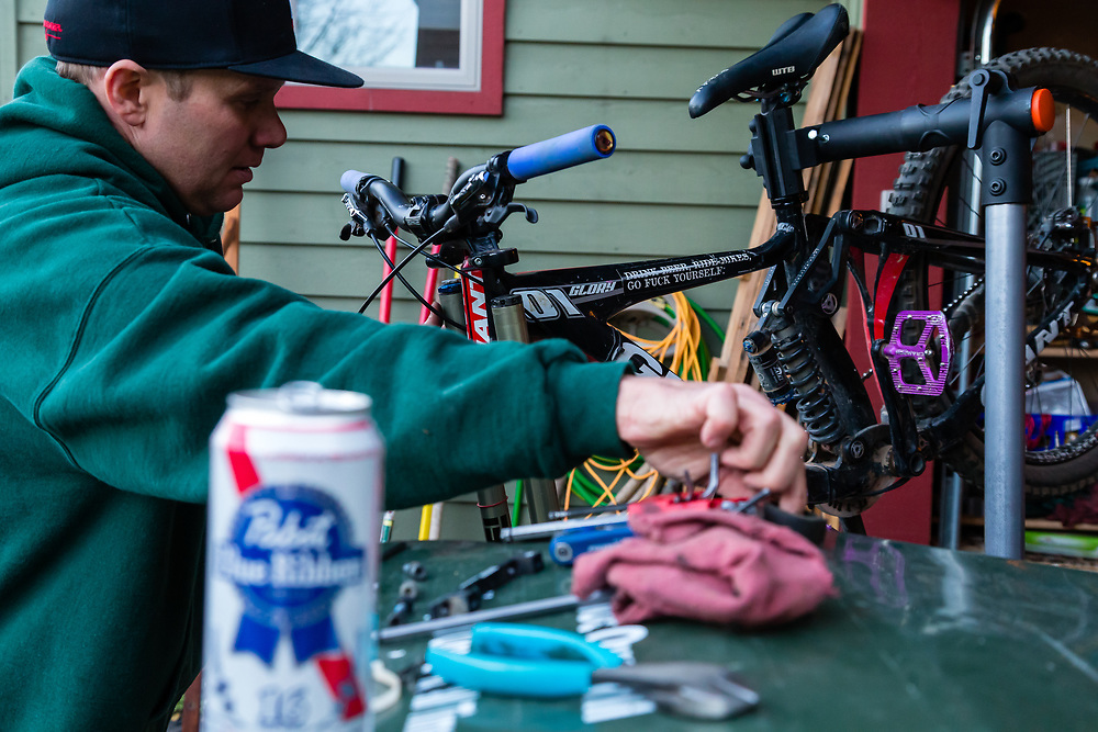 Harlan Hottenstein works on a bike in his garage at the base of Teton Pass.