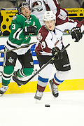 DALLAS, TX - SEPTEMBER 26:  Nathan MacKinnon #29 of the Colorado Avalanche controls the puck against the Dallas Stars on September 26, 2013 at the American Airlines Center in Dallas, Texas.  (Photo by Cooper Neill/Getty Images) *** Local Caption *** Nathan MacKinnon