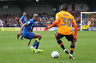 AFC Wimbledon midfielder Jimmy Abdou (8) tracking Oldham Athletic midfielder Tope Obadeyi (30)during the EFL Sky Bet League 1 match between AFC Wimbledon and Oldham Athletic at the Cherry Red Records Stadium, Kingston, England on 21 April 2018. Picture by Matthew Redman.