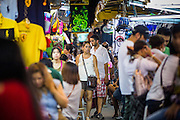 4 JUNE 2013 - BANGKOK, THAILAND:  Tourists in the Patpong Night Bazaar in Bangkok. Patpong was one of Bangkok's notorious red light districts but has been made over as a night market selling clothes, watches and Thai handicrafts. The old sex oriented businesses still exist but the area is now better known for its night shopping.      PHOTO BY JACK KURTZ