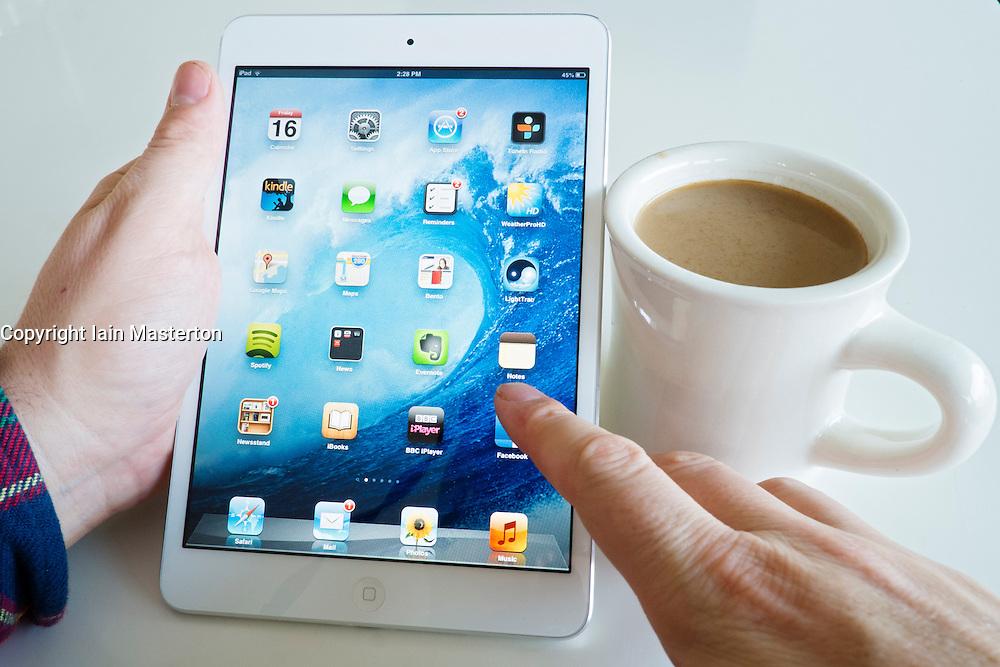 Using iPad mini tablet computer