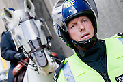 The face of protest - Financial fools day in the City.  Protestors take to the streets and riot police are deployed near the Bank of England. © Guy Bell Photography, GBPhotos