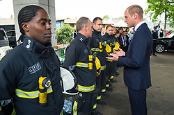 The Duke of Cambridge meets firefighters during a visit to the Westway Sports Centre, London, which is providing temporary shelter for those who have been made homeless in the Grenfell Tower disaster.