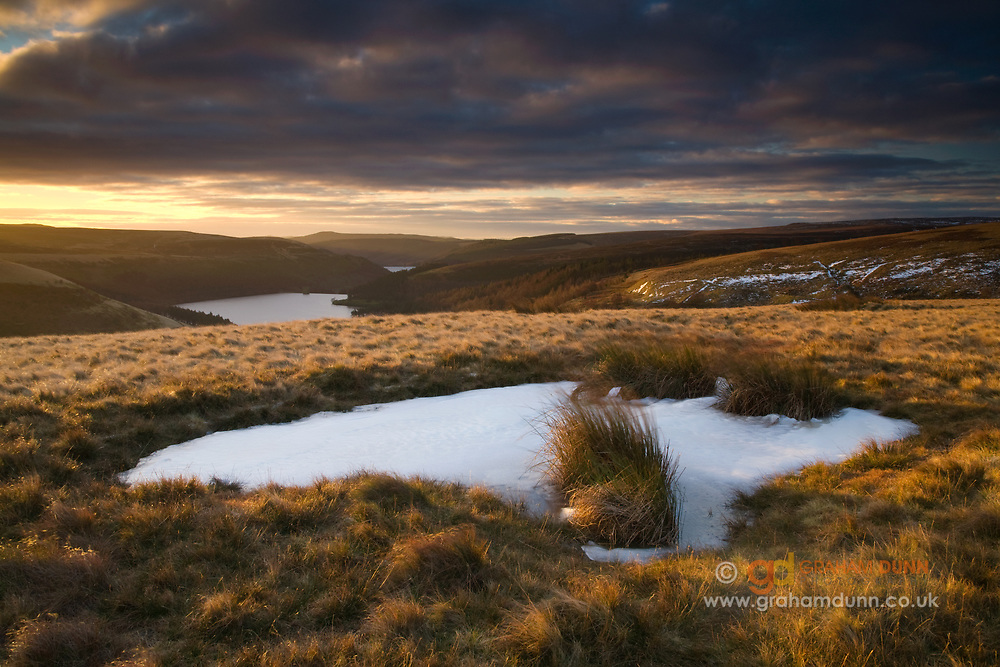 Ox Hey stands above the northern end of Howden Reservoir and offers panoramic views. Derwent Reservoir is also visible (just) in the distance. A dramatic winter sunrise in the Derbyshire Peak District, England, UK. 'Commended' in The Landscape Photographer of the Year 2011.