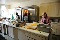 Volunteers help prepare the noon meal at the First United Methodist Church in Salinas, California. The church established a program which provides meals, counseling resources and occasional shelter to people in need. Basic rules, a generous spirit and a firm hand keep the program alive with minimal outside funding.