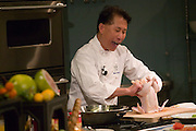 USA_060106_Yan15_rwx.tif.Martin Yan, chef, at Copia: The American Center for Food, Wine, and the Arts. Martin Yan gave a cooking demonstration of 'fire cracker chicken' at Copia's Meyer Food Forum cooking amphitheater. Napa, California. Napa Valley..