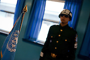 "A South Korean soldier inside one of the buildings at the Joint Security Area (JSA). The Joint Security Area or Panmunjom, often called the ""Truce Village""  is the only portion of the Korean Demilitarized Zone (DMZ) where South and North Korean forces stand face-to-face. The area is used by the two Koreas for diplomatic engagements and, until March 1991, was also the site of military negotiations between North Korea and the United Nations Command (UNC). South Korea, Republic of Korea, KOR, 23rd of March 2010."