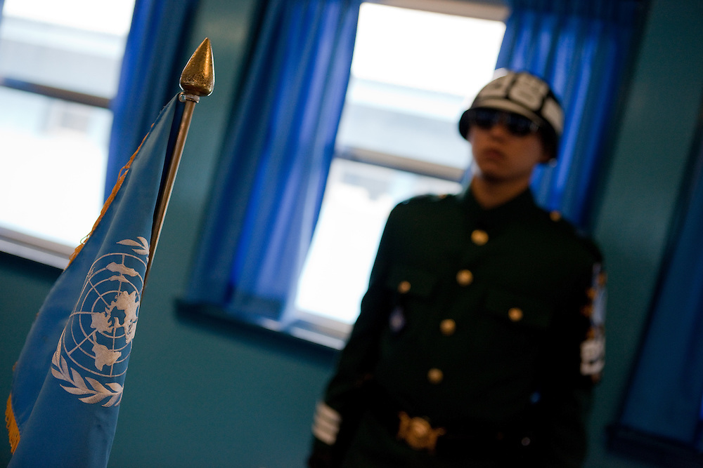 """A South Korean soldier inside one of the buildings at the Joint Security Area (JSA). The Joint Security Area or Panmunjom, often called the """"Truce Village""""  is the only portion of the Korean Demilitarized Zone (DMZ) where South and North Korean forces stand face-to-face. The area is used by the two Koreas for diplomatic engagements and, until March 1991, was also the site of military negotiations between North Korea and the United Nations Command (UNC). South Korea, Republic of Korea, KOR, 23rd of March 2010."""