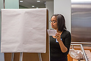 Purchase, NY – 31 October 2014. Chyna Artist, from the Saunders Trades and Technical High School team, making notes on the presentation easel. The Business Skills Olympics was founded by the African American Men of Westchester, is sponsored and facilitated by Morgan Stanley, and is open to high school teams in Westchester County.