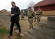 © Licensed to London News Pictures. 09/03/2012. Copedown Hill, UK. Secretary of Defence Philip Hammond (L) leaves the base with Brigadier Doug Chalmers after visiting troops who are being deployed to Afghanistan next month. The 12th Mechanized Brigade (12 Mech Bde) at Copehill Down, Salisbury Plain Training Area, Wiltshire, on FRIDAY 09 MARCH 2012, as it prepares to deploy to Helmand Province, Afghanistan, on Operation Herrick 16, in the Spring of this year. The Brigade were performing a dynamic demonstration of combined Afghan/ISAF operations supported by surveillance assets and casualty evacuation capability. Tornado GR4 fast jest ground support was also displayed.. Photo credit : Stephen SImpson/LNP