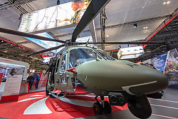 © Licensed to London News Pictures. 10/09/2019. London, UK. A military attack helicopter at DSEI. Defence & Security Equipment International (DESI) is the worlds largest arms fair and is held every two years in London. Photo credit: Peter Manning/LNP