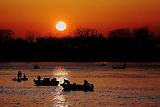Walleye fishing is a big event each spring on the Fox River in De Pere, Wisconsin. The area nearest to the De Pere Dam sometimes holds 300 anglers in boats and a similar number on the shoreline. The setting sun is not a problem for these guys.