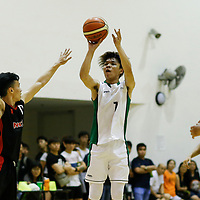 Zoel Lee (#7) of Republic Polytechnic shoots the ball against (#11) of Nanyang Technological University.
