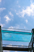 """London, United Kingdom, Jun 3, 2021: General pictures show a 25-metre sky pool in Embassy Gardens linking two residential buildings in London's Nine Elms, floating 10 storeys above ground. The Sky Pool, described as """"the world's first floating pool"""", is only open to some of the development's residents, where rent is from about £1,800 to £6,500 per month. (Photo by Vudi Xhymshiti)"""