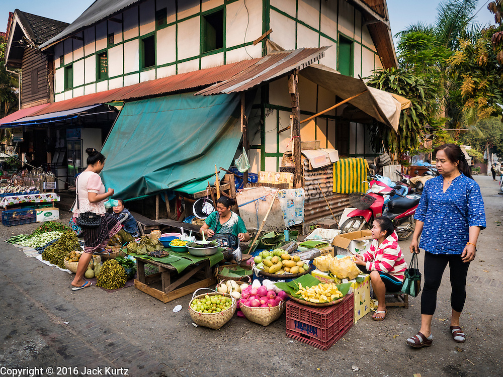 """13 MARCH 2016 - LUANG PRABANG, LAOS: A home being refurbished in the market in Luang Prabang. Many homes like this are being turned into guest houses and boutique hotels. Luang Prabang was named a UNESCO World Heritage Site in 1995. The move saved the city's colonial architecture but the explosion of mass tourism has taken a toll on the city's soul. According to one recent study, a small plot of land that sold for $8,000 three years ago now goes for $120,000. Many longtime residents are selling their homes and moving to small developments around the city. The old homes are then converted to guesthouses, restaurants and spas. The city is famous for the morning """"tak bat,"""" or monks' morning alms rounds. Every morning hundreds of Buddhist monks come out before dawn and walk in a silent procession through the city accepting alms from residents. Now, most of the people presenting alms to the monks are tourists, since so many Lao people have moved outside of the city center. About 50,000 people are thought to live in the Luang Prabang area, the city received more than 530,000 tourists in 2014.    PHOTO BY JACK KURTZ"""