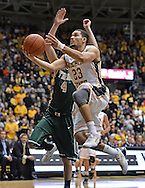 WICHITA, KS - NOVEMBER 14:  Guard Fred VanVleet #23 of the Wichita State Shockers drives to the basket against guard Omar Prewitt #4 of the William & Mary Tribe during the first half on November 14, 2013 at Charles Koch Arena in Wichita, Kansas.  (Photo by Peter G. Aiken/Getty Images) *** Local Caption *** Fred VanVleet;Omar Prewitt