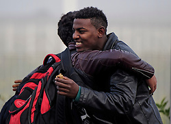 © Licensed to London News Pictures. 24/10/2016. Calais, France. Two migrants embrace as they say goodbye to each other, before being separated during the evacuation and demolition of the migrant camp in Calais, known as the 'Jungle'. French authorities have given an eviction order to thousands of refugees and migrants living at the makeshift living area of the French coast. Photo credit: Ben Cawthra/LNP