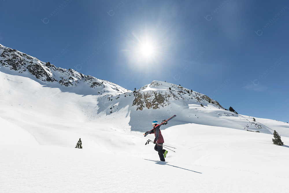 Female skier going up the mountain Backcountry skiing