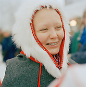 A Sami woman in Gakti, traditional dress, in Lapland, Sweden
