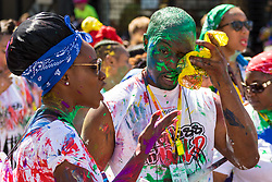 London, August 27 2017. A man wipes paint out of his eyes as Family Day of the Notting Hill Carnival gets underway. The Notting Hill Carnival is Europe's biggest street party held over two days of the bank holiday weekend, attracting over a million people. © Paul Davey.