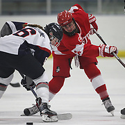 Nora Maclaine, (left), UConn, and Maddie Elia, Boston University, challenge during the UConn Vs Boston University, Women's Ice Hockey game at Mark Edward Freitas Ice Forum, Storrs, Connecticut, USA. 5th December 2015. Photo Tim Clayton