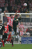 Photo: Pete Lorence.<br />Lincoln City v Milton Keynes Dons. Coca Cola League 2. 16/09/2006.<br />Adolfo Baines clears the ball