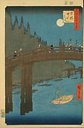 Bamboo Yards, Kyobashi Bridge', 1857. From 'One Hundred Famous Views of  Edo' (Tokyo). Utagawa Hiroshige (1797-1858) Japanese Ukiyo-e artist. By moonlight pedestrians cross bridge. Man poles  boat on river. Bamboos on left.