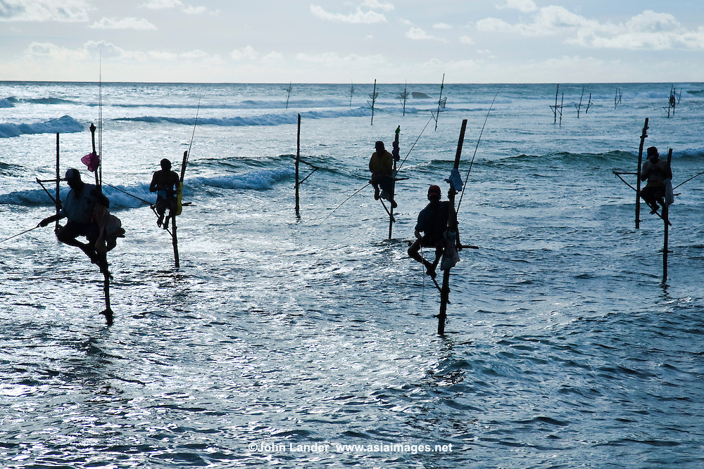 Sri Lankan Stilt Fishermen - Stilt fishing is fishing in relatively shallow water on a platform made up of a stilt - a common method used by Sri Lankan fisherman when fishing in or arround reefs not far away from the shore.  Most of the stilt fishing is done along the South Coast of Sri Lanka near the village of Kogala.