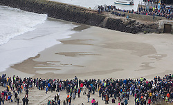 © Licensed to London News Pictures. 11/11/2018. Folkestone, UK. The incoming tide begins to reclaim a giant sand portrait of First World War poet Wilfred Owen on the beach at Folkestone, Kent during an Armistice Centenary event entitled 'Pages of the Sea'. Portraits are being created by communities on 32 beaches around the UK to say goodbye and thank you, to the millions of men and women who left these shores during the war, many never to return. Lieutenant Wilfred Edward Salter Owen, MC died on 4th November 1918 only days before the Armistice. One of Britain's most celebrated war poets - his short career was directly inspired by the conflict – he composed nearly all his works from August 1917 to September 1918, many published posthumously. Photo credit: Peter Macdiarmid/LNP