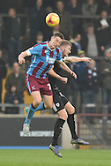 Murray Wallace of Scunthorpe United and Michael Smith of Barnsley FC go for the ball during the Sky Bet League 1 match between Scunthorpe United and Barnsley at Glanford Park, Scunthorpe, England on 31 October 2015. Photo by Ian Lyall.