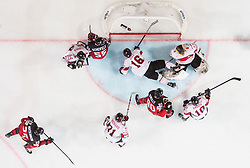 Andres Ambuhl of Switzerland, Leonardo Genoni of Switzerland, Raphael Diaz of Switzerland, Ryan O Reilly of Canada, Mark Scheifele of Canada, Tanner Richard of Switzerland and Philippe Furrer of Switzerland during the 2017 IIHF Men's World Championship group B Ice hockey match between National Teams of Canada and Switzerland, on May 13, 2017 in AccorHotels Arena in Paris, France. Photo by Vid Ponikvar / Sportida