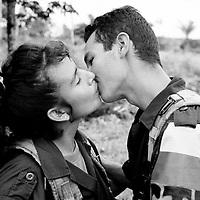 Marie Sol and her boyfriend Bernardo kissing near their FARC camp in Caqueta.
