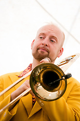 On Trombone and Washboard is Alex Douglas..9 September 2012.Image © Paul David Drabble