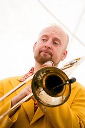 On Trombone and Washboard is Alex Douglas..9 September 2012.Image © Paul David Drabble