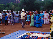 Carla Goseyun's Godfather, Glen Cromwell, dancing with women at Carla's White Mountain Apache Traditional Sunrise Ceremony, Whiteriver, Arizona.  Please Note: A small extra licensing fee needs to be paid to the Goseyun Family for usage of this photo. Contact Fred Hirschmann for more information. Thanks.